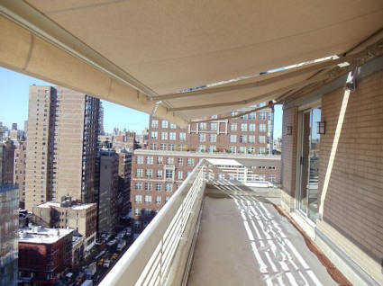 Extended retractable awning on Penthouse